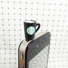 ★The information of Cute Starbucks Coffee Milk Mark Cup Dust Plug  This anti-dust stopper plug is fit for all cellphones which earphone jack is 3.5mm.Such as ipad, itouch, iPhone 4 4s 5 ,HTC, Samsung,and all notebook,MP3, MP4,MP5 etc. Almost 97% of the smart phone headphone jack all around the world is 3.5mm. As all know, dust is the NO. 1 killer for your precision and loved smart phone. Very practical and beautiful gift for yourself ,your friends and so on.  Material: Resin Starbucks Cup…