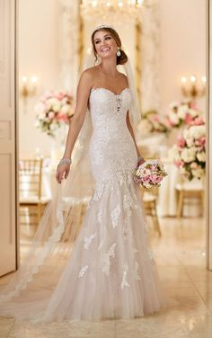 Standout lace appliques on fine tulle work together to create a stunning design from Stella York. See all the details inside.