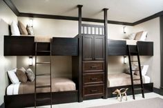 Stylish black bunk beds for four with central storage compartments
