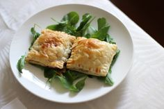 Crunchy puff pastry pillows stuffed with blue cheese, pear and honey