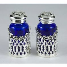 "Godinger PIERCED SALT/PEPPER PR. by TheCozyPineapple. $15.99. Measures approx: 3.25"" tall x 1.25"" diameter. Silver plated and cobalt glass material. Set of 2 shakers. PIERCED SILVER PLATED PAIR OF SALT AND PEPPER SHAKERS. Save 53%!"
