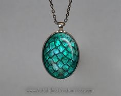 The texture if this piece would make a gorgeous painting.  Game of Thrones Jewelry, Turquoise Dragon Egg Pendant