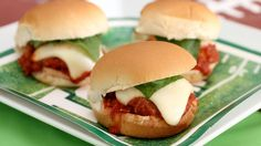 """All-American sliders become """"molto Italiano"""" in this crowd-pleasing recipe that features authentic meatballs, melted mozzarella and fresh leaves of basil."""