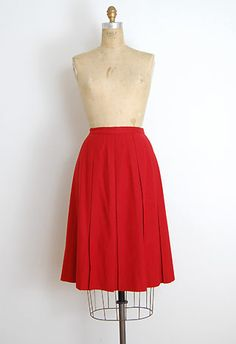 $78.00  Vintage 1940s Jantzen red wool skirt with large pleats. A fantastic classic skirt with a slight a-line shape. Would look fabulous with black tights and little oxfords.