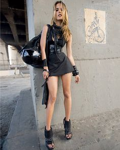 Cotton dress, Hugo, $525, call 800-HUGO-BOSS. Rubber wreath necklace, Subversive Jewelry by Justin Giunta, $1,400. Rubber necklace, Keni Valenti, $400. Black leather multistrand bracelet, Emporio Armani, price upon request. Cuffs, Natalia Brilli, $300–$320. Leather cuff, from Trash and Vaudeville, NYC. Leather tote bag, Cole Haan, $398. Clutch, Coach, $198. Helmet, Outlaw Helmets. Leather sandals, Alexander Wang, $575.   - ELLE.com