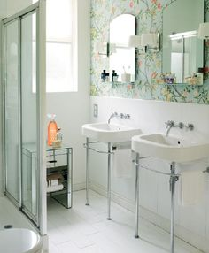 pretty wallpaper adds vintage flair to a bathroom // coco + kelley