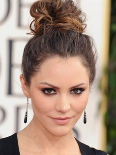 KATHARINE MCPHEE Two words: smoking hot. When McPhee walked down the red carpet, the Twitterverse exploded with covetous tweets about her makeup, hair, body, and dress. Some could argue her messy topknot was too casual for the occasion, but we think it had just the right amount of coolness and easiness to counterbalance her edgy getup.