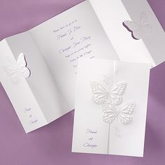 Graceful, pearl-embossed butterflies pull apart to display your invitation wording. At the top of your enclosure is a matching pearlized butterfly.