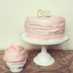 Baby girls first birthday cake and mini smash cake in pale pink ruffles and custom white chocolate cake topped airbrushed gold  http://www.crumbandberry.com