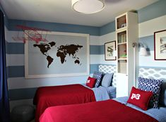 Shared boys' bedroom in blue, gray, and red with two twin beds and a cute DIY map project. Nice, tall, narrow cabinet and lamps between beds. Heart Organizing