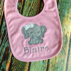 A personal favorite from my Etsy shop https://www.etsy.com/listing/262037888/personalized-bib-with-elephant-applique