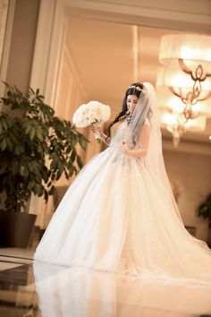Real bride in Ines Di Santo. Ballgown Dresses. Wedding dress with sleeves. Wedding dress from Solutions Bridal in Orlando, Florida