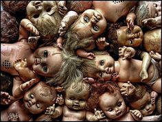 Creepy dolls. To me all dolls are creepy, even Barbie. Why haven't they made a Voo-doo Barbie?