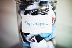 shower activity:  guests take turns entering in their guesses for the number of baby socks in the jar (mom to be gets to keep all socks!)