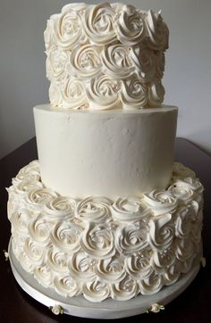 3 Tier buttercream wedding cake decorated with buttercream rosettes and sugar pearls. Wedding Cakes York PA