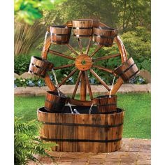 "Wagon Wheel Water Fountain Country charm abounds in this casual all-wood water fountain! An old-fashioned wagon wheel becomes a quaint backdrop for a dazzling display as water dances from bucket to bucket. Impressively sized at 33"" high for serious style impact!  Request a World of Products E-Catalog onsite at Milestones Marketplace http://milestonesmarketplace.blogspot.com/p/home-garden-decor.html"