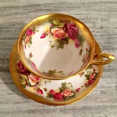 Gorgeous vintage Royal Chelsea Golden Rose Tea Cup and saucer with pretty pink roses. This heavy gold detailed teacup comes with a wide-mouth cup. Perfect as a cabinet piece or for enjoying sipping on your favorite tea. English Bone China made in England. Pattern number #3983A.