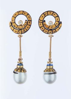 Michael Boyd gold earrings with pearl drops.