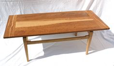 Coffee table with floating top made of brown oak by David Towers cabinet-maker www.davidtowers.biz