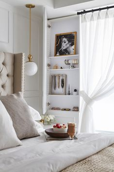 chic white bedroom with built-in storage