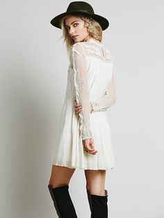 Write About Love Dress | Sheer chiffon long-sleeved dress with embroidered detailing. Upper portion and sleeves are dotted mesh. High neckline. Lined.
