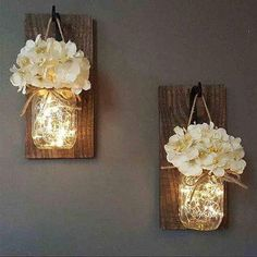 Product Description: Rustic Mason Jar Wall Sconce with LED Fairy Lights & Choice of Artificial Hydrangeas Flowers for Country Home Bedroom wedding Cafe Bar Party Wall Decoration Features: This is the perfect wall decor as you can switch out the flowers a Mason Jar Wall Sconce, Hanging Mason Jars, Rustic Mason Jars, Mason Jar Lighting, Mason Jar Bathroom, Mason Jar With Lights, Mason Jar Kitchen Decor, Jars Decor, Kitchen Lighting
