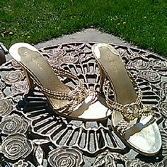 Enzo angiolini size 7.5 Gorgeous gold shoes with braided detail in good condition there is a dent on the heel as shown in the picture and few scrapes. Price reflects Enzo Angiolini Shoes Heels
