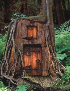 fairie house, I love the irons color fading and blending with the door's wood