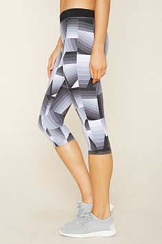 A pair of stretch knit athletic leggings featuring an allover geo print with a capri length, a drawstring elasticized waist, a hidden key pocket,...