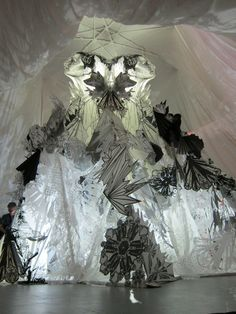 """Swoon - """"Art in the Streets"""" at the MOCA.  Illuminated paper and cloth make for a beautifully imposing installation from this Brooklyn-based graffiti artist."""