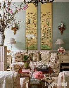 Designer Charlotte Moss's message is: Mix the antique with the new. Which is which here in this Manhattan townhouse? Chinoiserie panels on tea paper, gilt brackets with blanc de Chine canisters, red lacquer bamboo coffee table, loveseat in Daphne's Mystery, by Charlotte Moss for Brunschwig & Fils. Related: Fabulous Dining Rooms
