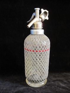 Vintage Aerators Ltd of London red line wire mesh and glass seltzer soda syphon. Classic bar ware. - $25    This fantastic and classic Aerators Ltd of London wire mesh and Glass Soda bottle is in fantastic condition given it's age.     This is a very functional seltzer bottle that would require the C - 02 cartridge and a good cleaning and you could make your own soda water for your favorite cocktail.     Perfect for that home bar or the mixologist