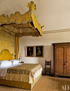 The Yellow Bedroom features an antique baldachin; the jute floor covering is by IKEA.