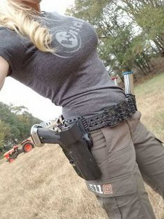 Janna Reeves showing off her STI 2011 in an LAG Tactical holster - Imgur