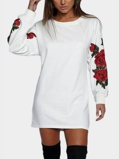 Work this seriously standout mini dress this season. It is adorned with round neck, long sleeves and rose embroidery. We love it with high heels.
