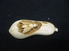 684: Chinese Carved Ivory Netsuke of a Bee eating away