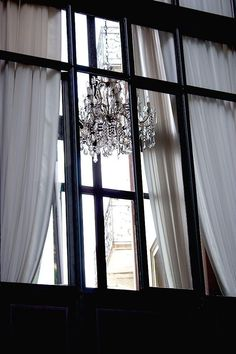 chandelier through the window. Chandelier Bougie, Chandeliers, French Chandelier, White Cottage, Paris Apartments, Through The Window, White Houses, Shades Of Black, Color Negra