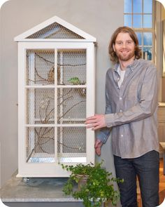 Would love to have birds in a cage like this....if i was around enough on the weekends....lovebirds.