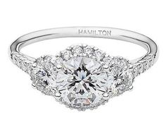 I love the shape and the three stones. If they let you play with metal color and stone color this ring could be perfect. so much potential. <3 Hamilton Lisette 3-stone ring