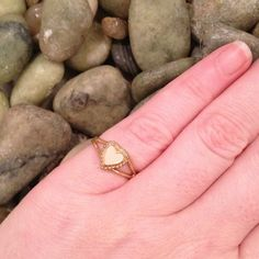 Vintage Avon Heart Gold-toned Ring Fully adjustable. I've had this ring since the 1980's. in perfect condition. Would make a good gift for a little girl. No trades, please. Jewelry Rings
