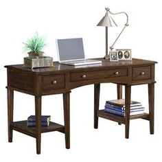 """Give your den, master suite, or home office a studied air with this handsomely crafted desk, perfect for penning correspondence and working from home.    Product: Writing desk    Construction Material: Solids and wood composites    Color: Cherry   Features:  Ample convenient shelves and storage drawers    Simple styling    Will enhance any décor   Dimensions: 31"""" H x 56"""" W x 24"""" D     330"""