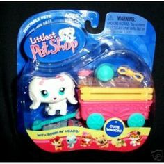 Littlest Pet Shop Pets On The Go Figure White Puppy Dog with Cute Wagon by Hasbro. $36.99. Brand new In box. Cute and Collectible. Name: Littlest Pet ShopManufacturer: HasbroSeries: Pet PairsRelease Date: October 2005Details (Description): Welcome a new friend into your very own LITTLEST PET SHOP, where all your pet-lovin' dreams come true! This cute little dog is ready to go along with you in her own little wagon! Adorable dog figure with bobblin' head comes with take...