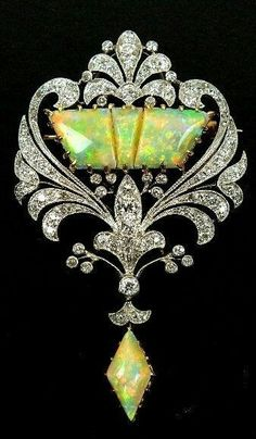 "jolaunay:  "" Early 20th century opal and diamond brooch  Source: indulgy  """
