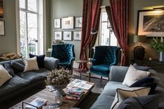 sumptuous living room design with tufted armchairs
