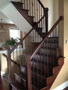 Oak staircase with wrought iron pickets