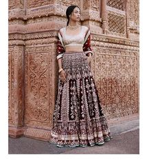Rich velvets marry intricate embroideries in this maroon lenhenga. Gota patti, dori, pearl, zardosi and sequin work whisper stories of lush trees and blooming flowers.  #AnitaDongre #TreeOfLove #AnitaDongreCouture #AnitaDongreBridalCouture