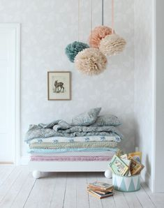 i think large tissue poms are too overdone these days, but these i don't mind. simple and i like how they are hung.