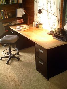 Make a desk with a door and file cabinets.
