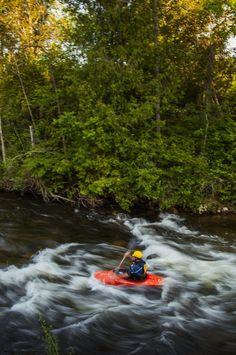 White water kayaking on Boardman River, Traverse City, Michigan.