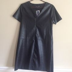 """NEW Faux Leather Black Dress Medium New Faux Leather dress. V-neck, invisible side zipper. 32""""L from back of neck to hemline. Washable One ❤️Clothing Dresses"""